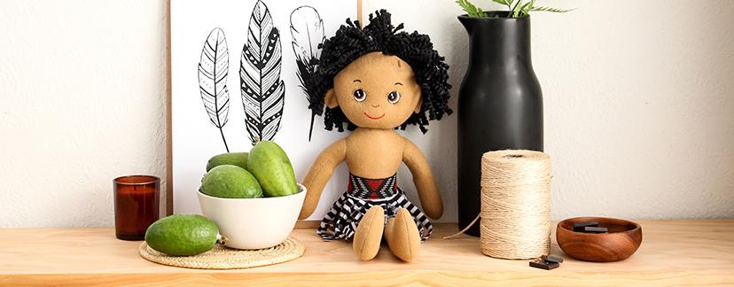 Maori soft doll boy on shelf